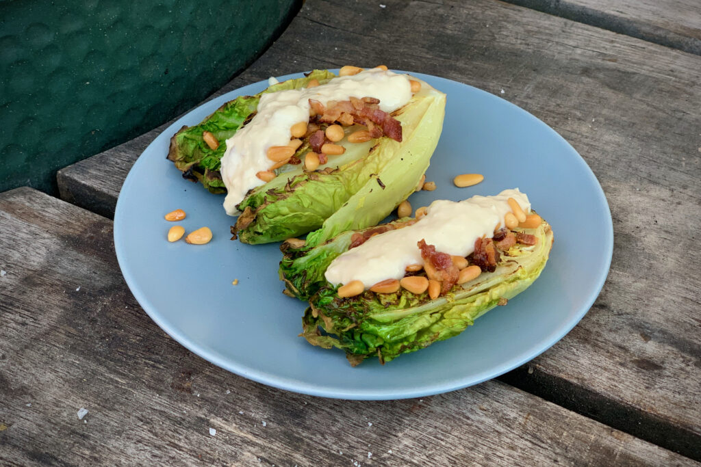 Grilled Gem Lettuce with Caesar dressing, pine nuts and bacon